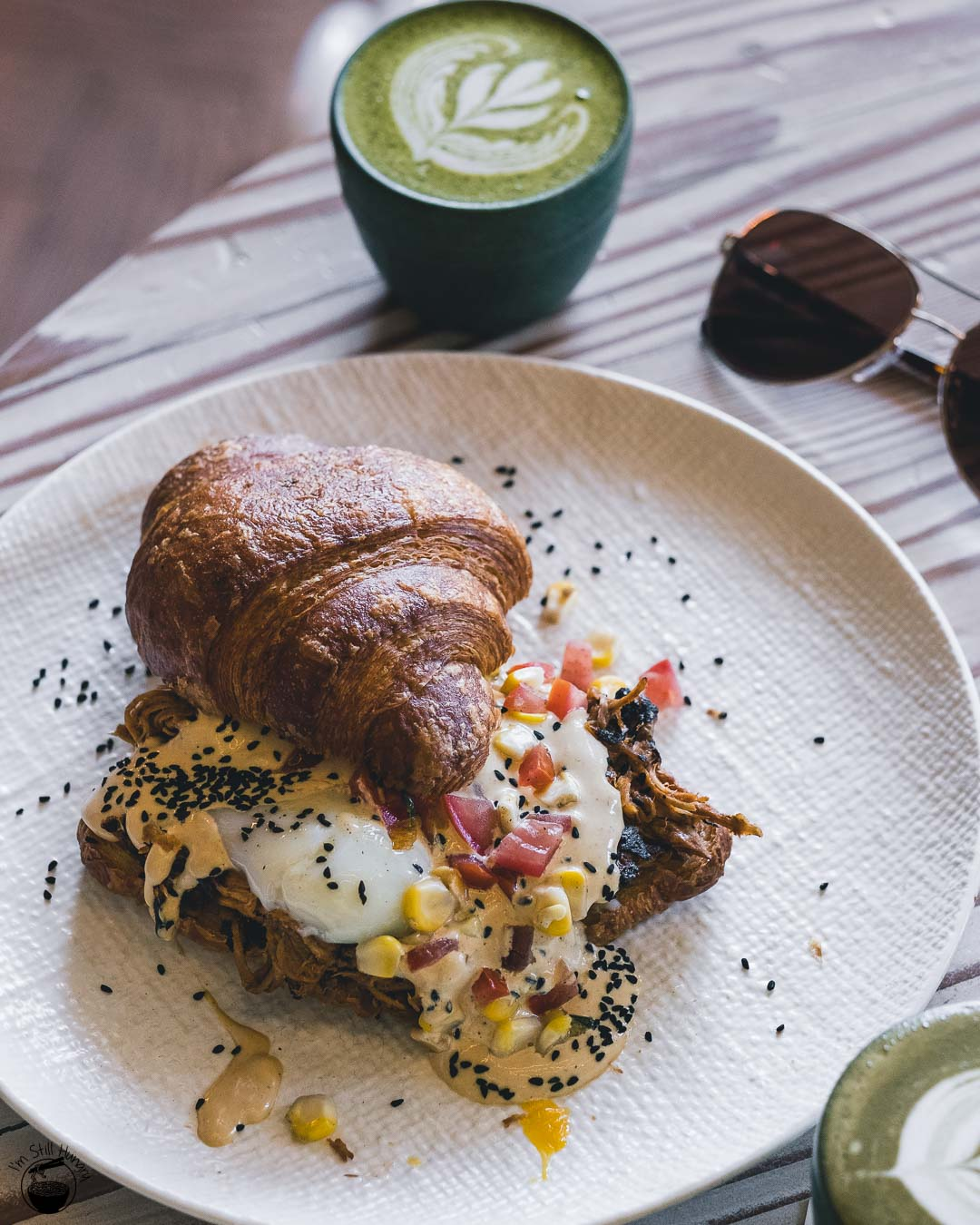 Auvers Cafe Rhodes Eggs benedict: pulled pork, onsen eggs, smoky ponzu hollandaise, corn salsa on a toasted croissant