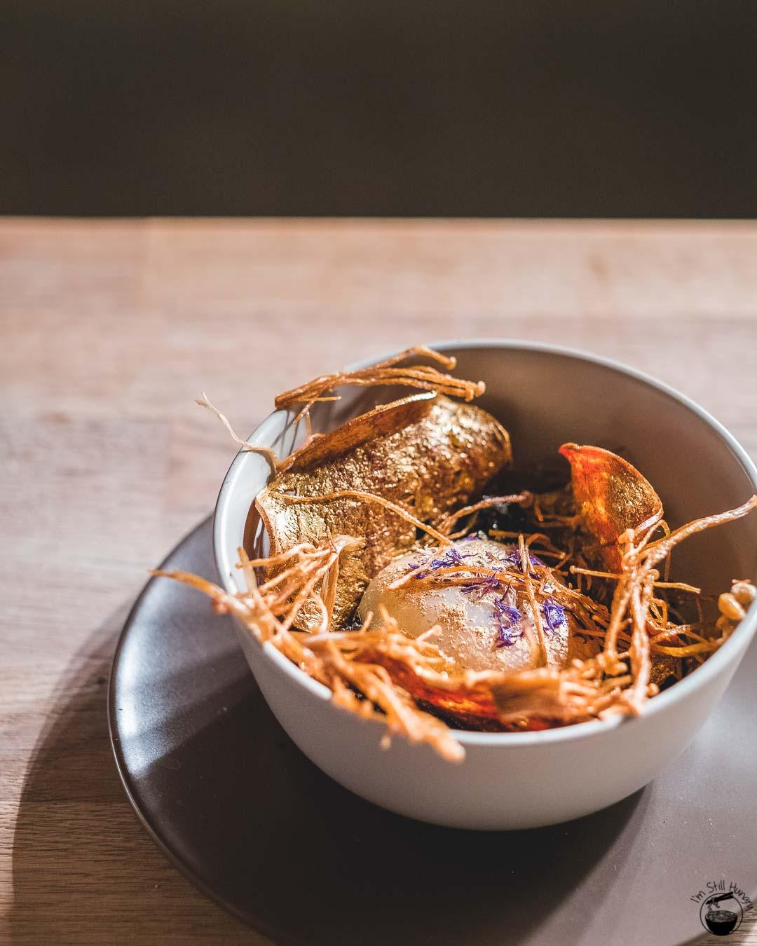 Blue Wren Restaurant Golden egg, bronzed spiced meats, squid ink rice, enoki mushrooms