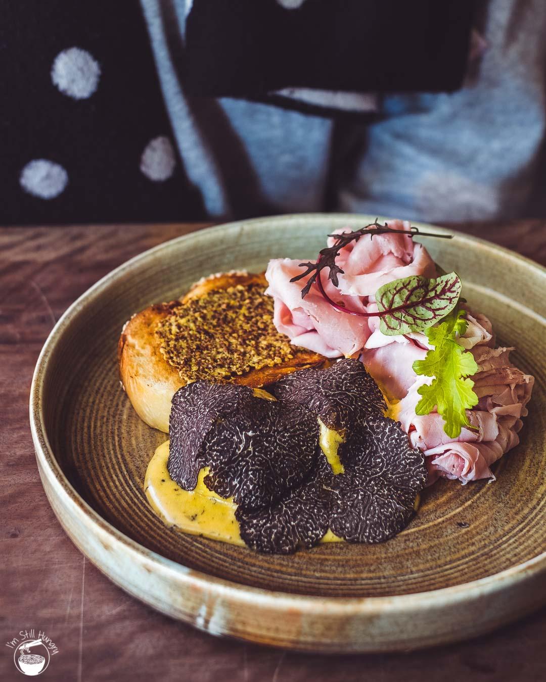 Cavalier Specialty Coffee Truffle gooey eggs, mustard & special hollandaise on challah toast w/truffle