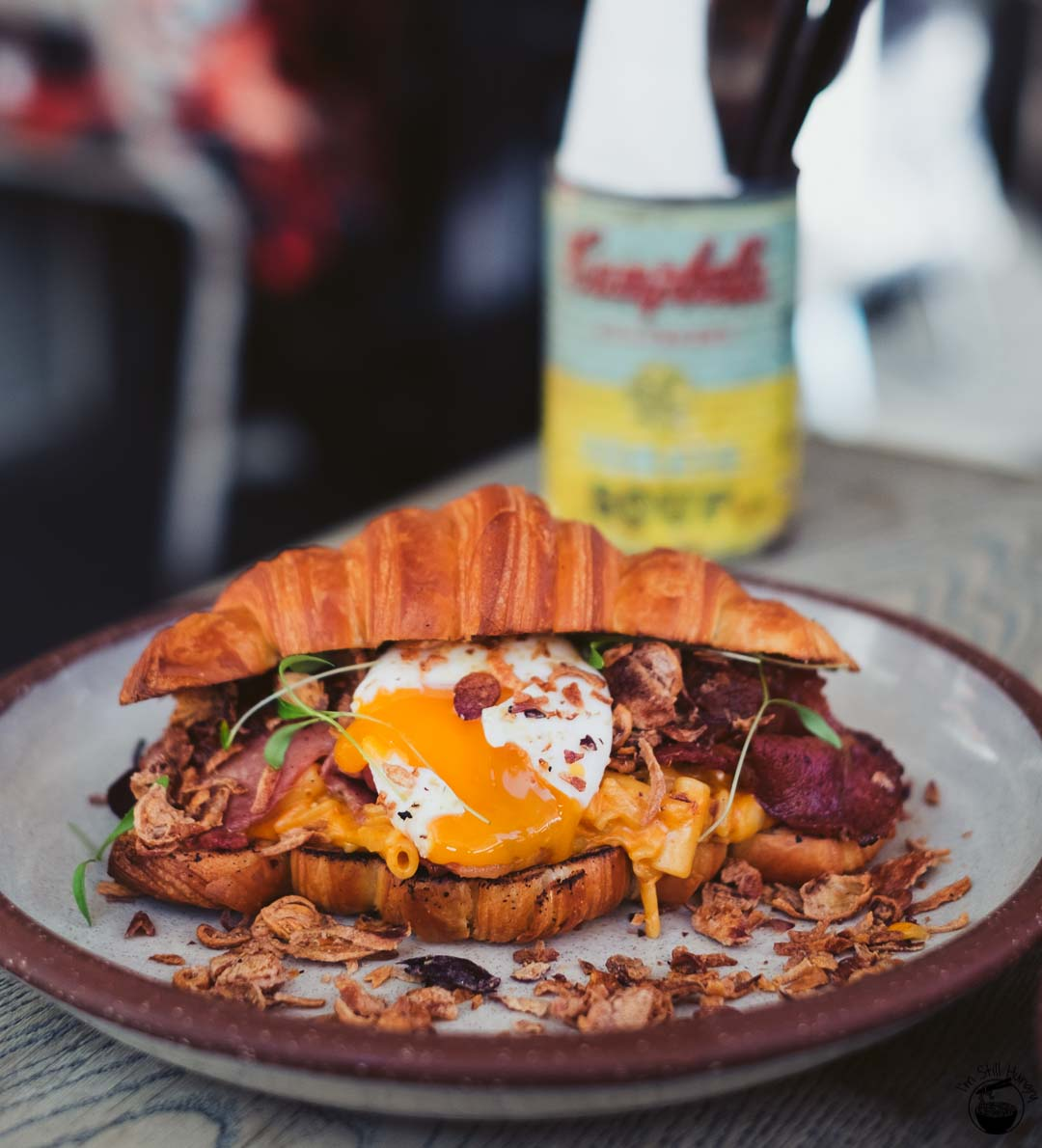 Cuckoo Callay Bacon Festival The Bacon Mac Daddy: double smoked bacon, bacon mac 'n' cheese, 63C egg, tomato relish & fried shallots in a croissant