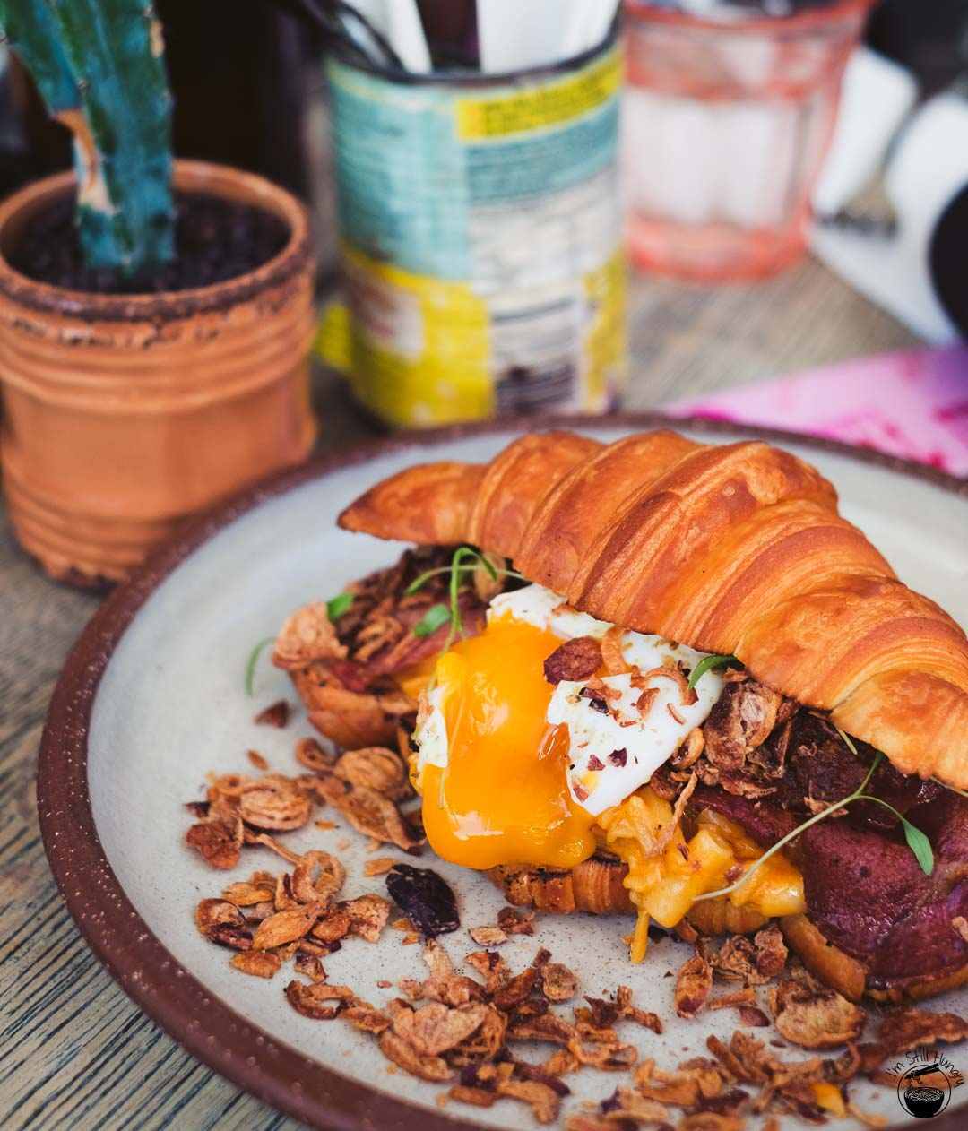 The Bacon Mac Daddy: double smoked bacon, bacon mac 'n' cheese, 63C egg, tomato relish & fried shallots in a croissant