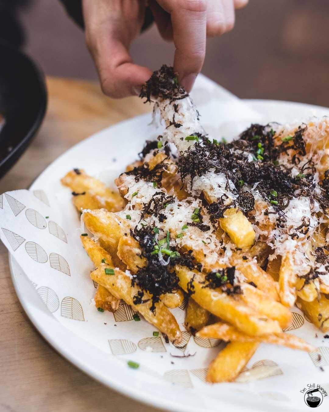 Devon Cafe Surry Hills Devon super fries: super crunch fries, cheese sauce, truffle oil, shaved WA truffle
