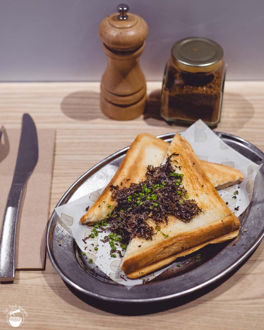 Devon Cafe Barangaroo Truffle jaffle: truffle mornay, truffle mushrooms, provolone, fresh black WA truffle