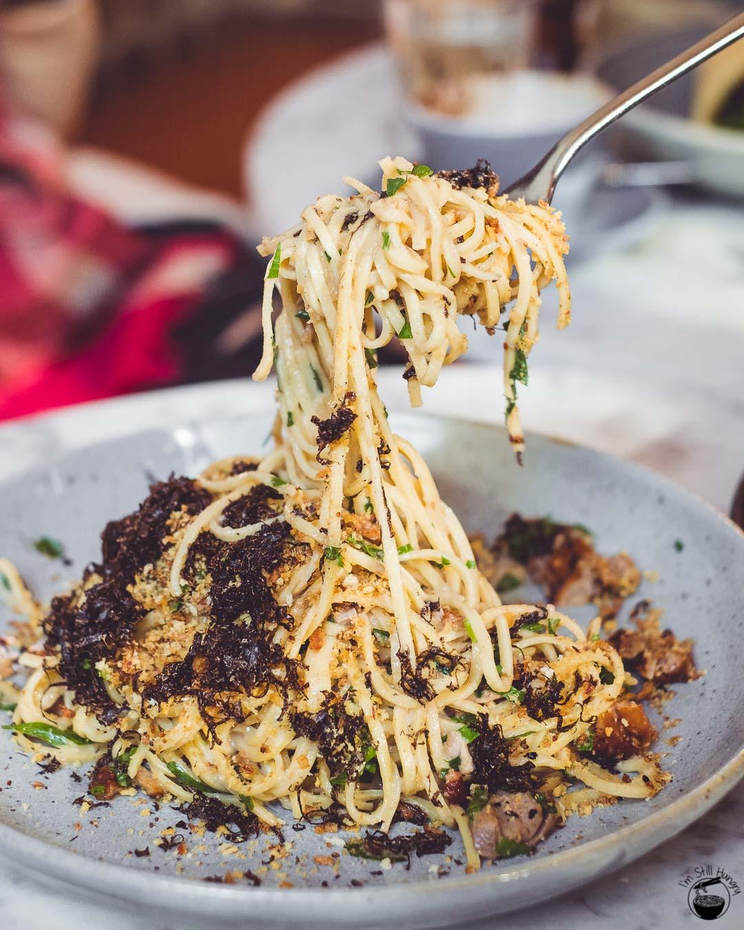 Three Williams Roasted Peking duck angel hair pasta: ginger-infused cream sauce, parsley, shaved truffle, fried onion crumb